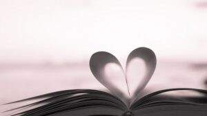 book with pages folded in to heart